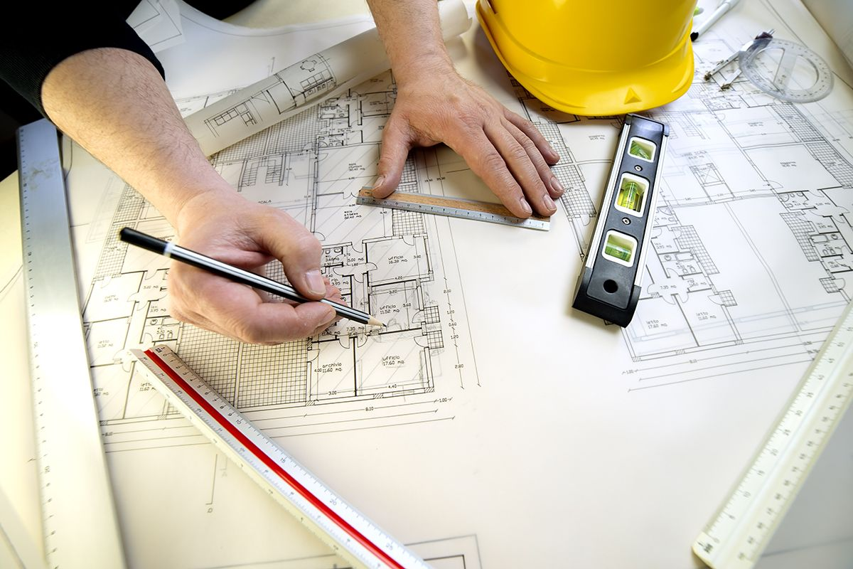 Builder Reviewing Detailed Construction Drawings