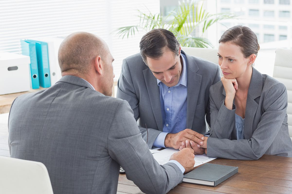 Lender Advising a Couple on Mortgage Financing for a Real Estate Transaction